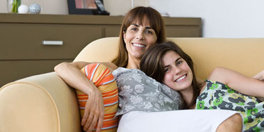 Mom and daughter on a couch