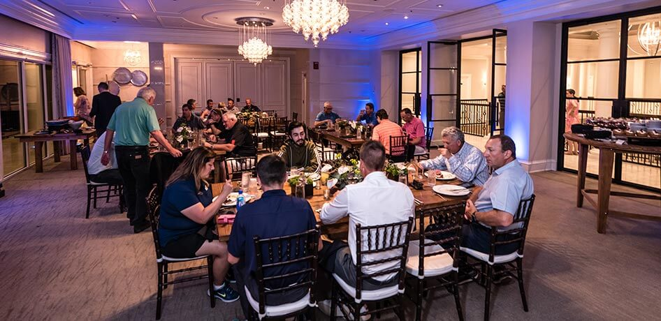 Event attendees eating dinner at Lake Nona Golf & Country Club