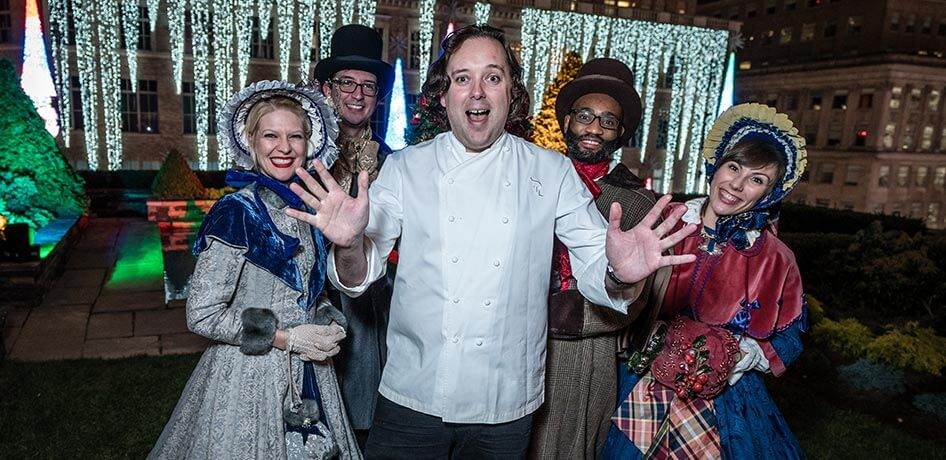 Chef with four old-fashioned carolers