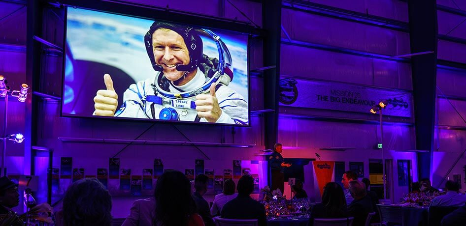 Stage featuring photo of an astronaut