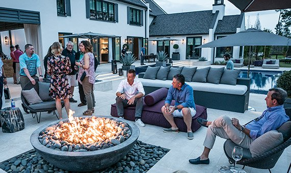 Henrik Stenson and attendees around fire pit