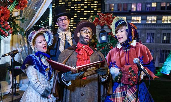 Four old-fashioned carolers singing