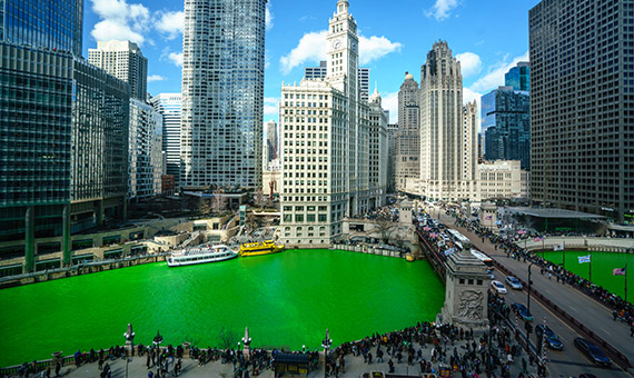 Chicago skyline with Chicago River dyed green