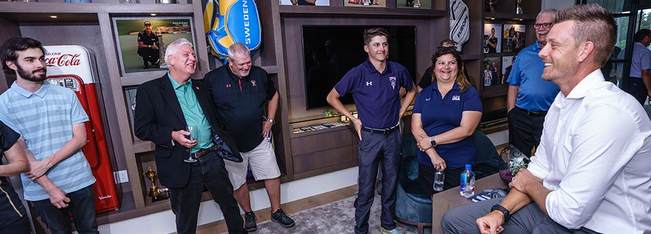Henrik Stenson in his home with event attendees