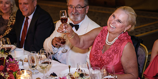 Guests toasting at dinner table