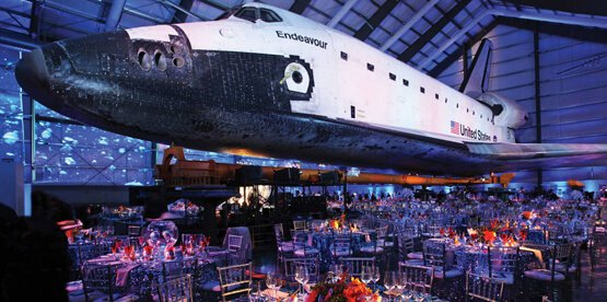 Space Shuttle Endeavor with tables set up below