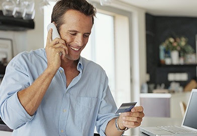 man on phone with credit card specialist
